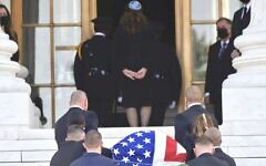 The flag-draped casket of the late Supreme Court Justice Ruth Bader Ginsburg arrives at the court in Washington, Sept. 23, 2020. Rabbi Lauren Holtzblatt of Adas Israel, a Conservative congregation in Washington, is at top of stairs. (Andrew Caballero-Reynolds/AFP via Getty Images)