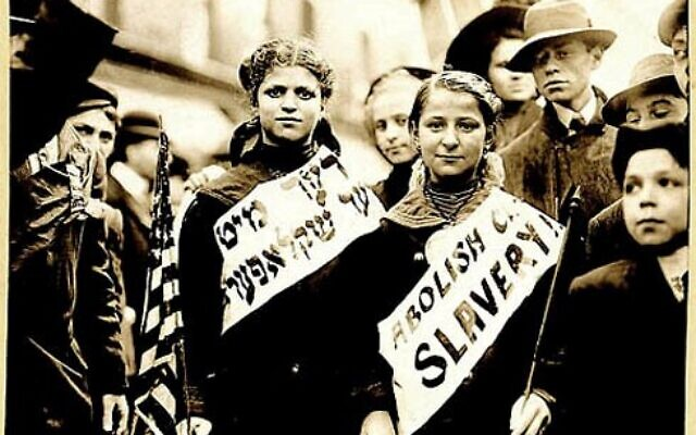 "Marchers bear signs reading ""Abolish [Child] Slavery"" in English and Yiddish, probably taken during May 1, 1909 labor parade in New York City. (George Grantham Bain Collection, Library of Congress via My Jewish Learning)"