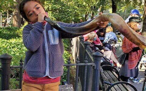 HAVING A BLAST: Theodora Helfand, age 6, blows the shofar at 106th and Broadway during Romemu's Rosh Hashanah celebrations, Sept. 20, 2020. (Photo courtesy of Howard Weiner)