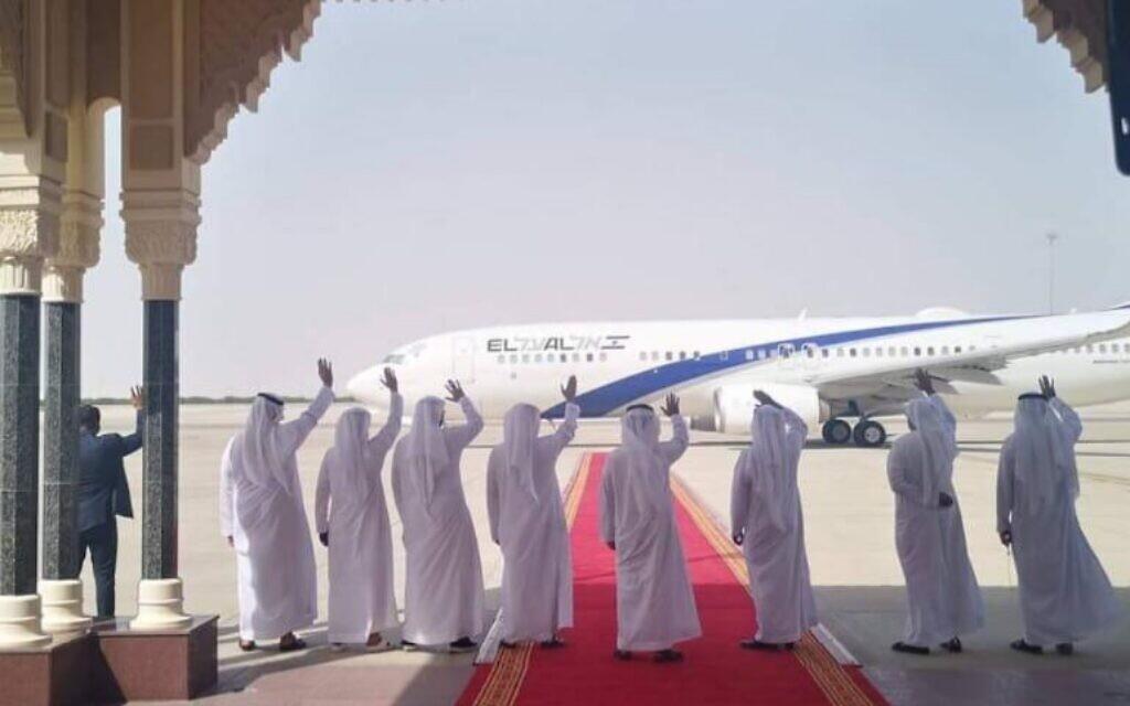 UAE delegates wave to the departing El Al plane at the end of the Israel-UAE normalization talks in Abu Dhabi, Sept. 1, 2020. (El Al spokesperson's office)