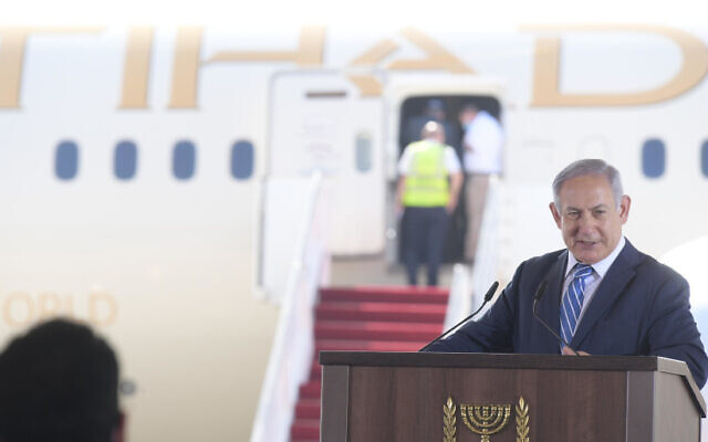 Prime Minister Benjamin Netanyahu welcomes the first UAE delegation to Israel on Tuesday, Oct. 20, 2020. The Etihad Airways flight was the first commercial shuttle from the United Arab Emirates to Israel, a fruit of the normalization agreement signed between the nations. (AMOS BEN-GERSHOM/GPO)