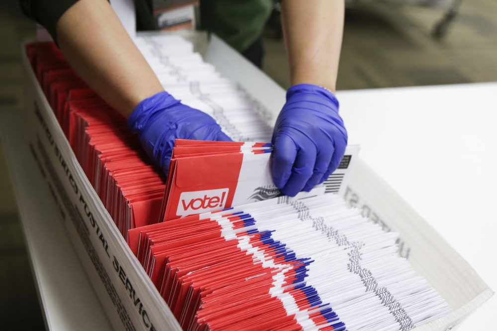 Election workers sort vote-by-mail ballots for the presidential primary at King County Elections in Renton, Washington on March 10, 2020. (Jason Redmond/AFP via Getty Images)