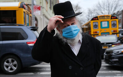 A man attends a funeral for a rabbi who died from the coronavirus in the Borough Park neighborhood. April 5, 2020. (Photo by Spencer Platt/Getty Images)