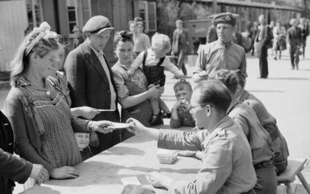 A Polish family registering at No. 17 Displaced Persons Assembly Centre in Hamburg Zoological Gardens, May 18, 1945. (No. 5 Army Film & Photographic Unit, Mapham J (Sgt). War Office Second World War Official Collection, Imperial War Museums)