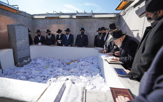 EMISSARY OF THE EMISSARIES: Rabbi Yehuda Krinsky, chairman of Merkos L'inyonei Chinuch, the educational arm of the Chabad-Lubavitch movement, prays at the resting place of the movement's late rebbe, Rabbi Menachem Mendel Schneerson, in Queens on behalf of virtual attendees of the International Conference of Chabad-Lubavitch Emissaries, Nov. 15, 2020. The annual gathering of 5,000 rabbis from 100 countries was held remotely this year. (Bentzi Sasson/Chabad.org)
