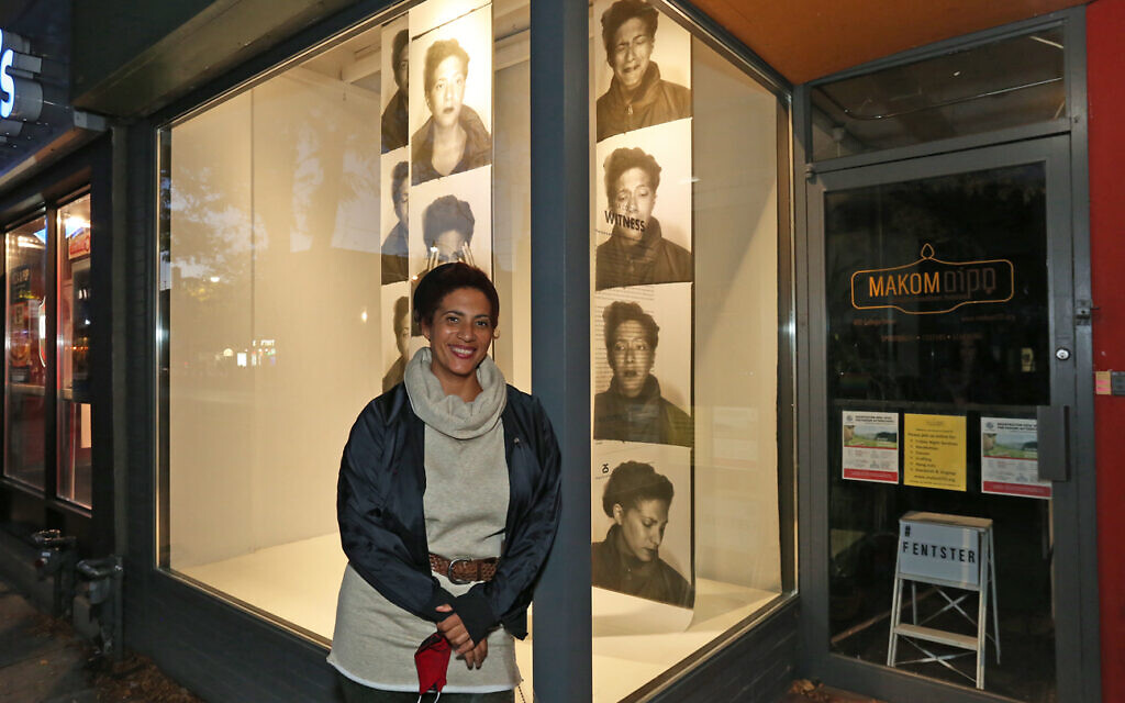 "Artist Ella Cooper in front of her installation, ""Witness,"" at the FENTSTER window gallery, Toronto. (Yvonne Bambrick)"