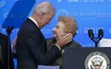 Then-Vice President Joe Biden Biden is introduced by Holocaust survivor Nesse Godin as he arrives to address the Jewish Federations of North America General Assembly in Oxon Hill, Md., Monday, Nov. 10, 2014. (AP Photo/J. Scott Applewhite via JTA)