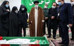 Iran's judiciary chief, Ayatollah Ebrahim Raisi, center, pays respects to the body of Mohsen Fakhrizadeh, the architect of Iran's military nuclear program, in Tehran, Nov. 28, 2020. (Mazan News Agency/AFP via Getty Images)