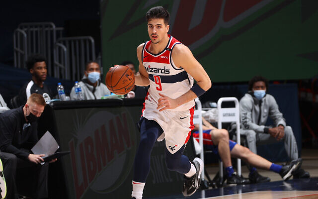 Deni Avdija of the Washington Wizards plays in a preseason game against the Detroit Pistons on Dec. 19, 2020 at Capital One Arena in Washington. He scored seven points in his NBA debut Wednesday night. (Ned Dishman/NBAE via Getty Images)