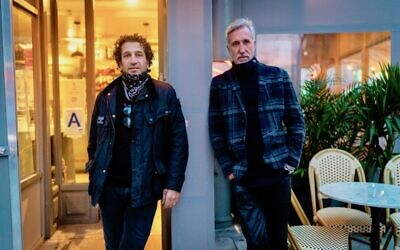 Shoo Shoo Nolita's owners, Robby Ozer, left, and Albert Bitton, right, at the restaurant's entrance, New York City, December 13, 2020. (Luke Tress/Times of Israel)