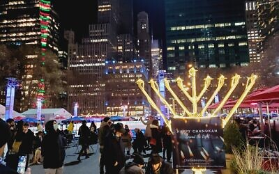 CITY OF LIGHT: A menorah placed by Chabad-Lubavitch in Bryant Park in Midtown Manhattan is part of the chasidic outreach movement's annual public Chanukah campaign, Dec. 10, 2020. (Chabad Lubavitch)