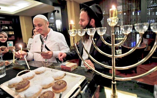 Israelis celebrate Chanukah for the first time at a hotel in Dubai, Dec. 10, 2020. (Karim Sahib/AFP via Getty Images)