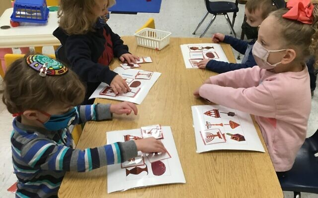 GETTING INTO THE SPIN: Children at Hebrew Academy of Nassau County's Early Childhood Center in West Hempstead prepare Chanukah projects. The holiday begins Thursday at sundown. (Courtesy.)