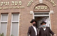 Men exit a yeshiva in Brooklyn's Borough Park, Sept. 29, 2020. (Daniel Moritz-Rabson)