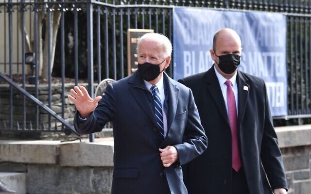 President Joe Biden leaves Holy Trinity Catholic Church in the Georgetown neighborhood of Washington, D.C. Jan. 24, 2021. His next stop was a Jewish-style deli where he picked up bagels. (Nicholas Kamm/AFP via Getty Images)