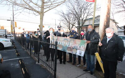 Local politicians and clergy led a candlelight walk and vigil on Staten Island to denounce white supremacist propaganda and last week's violence at the U.S. Capitol, Jan. 10, 2021. (Courtesy)