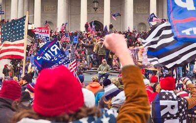 Protestors rush the Capitol steps during a pro-Trump demonstration in Washington, D.C., Dec. 6. 2020. (Brett Davis/Flickr Commons)