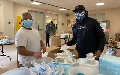 Volunteers at The Riverdale Y package medical supplies to be shipped to underserved communities around the world through the Afya Foundation, during the UJA-Federation of New York's region-wide MLK Day of Service, Jan. 18, 2021. (Courtesy)