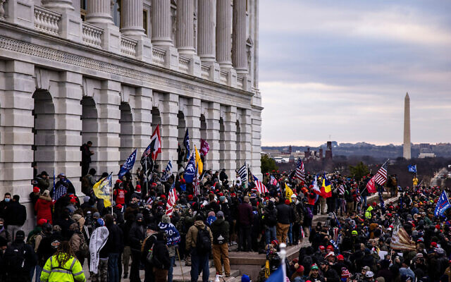 A pro-Trump mob storms the U.S. Capitol following a rally with President Donald Trump, Jan. 6, 2021. (Samuel Corum/Getty Images)