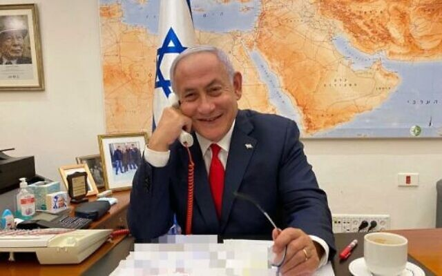 Prime Minister Benjamin Netanyahu speaks to President Joe Biden from his office in Jerusalem, Feb. 17, 2021. (Twitter)