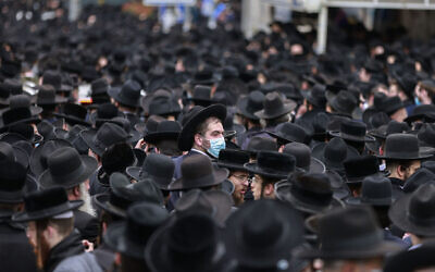 Thousands of haredi Orthodox Jews attended a funeral procession in Jerusalem for Rabbi Dovid Soloveitchik, the head of the Brisk Yeshiva, Jan. 31, 2021. (Menahem Kahana/AFP via Getty Images)