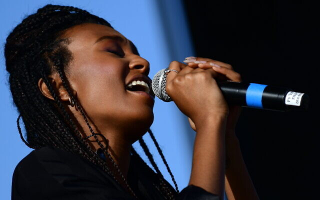 LIFT EVERY VOICE: Eden Alene sings at a protest against violence towards women at in Tel Aviv, on June 1, 2020. She is the first Ethiopian Israeli to represent Israel in the Eurovision Song Contest, which is being held in the Netherlands in May. (Tomer Neuberg/Flash90 via JTA)