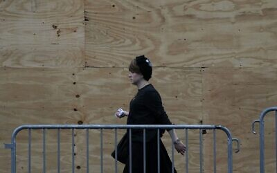 A woman is seen in a Brooklyn neighborhood on Sept. 29, 2020. (Timothy A. Clary/AFP via Getty Images)