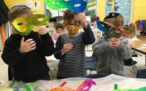MASKS ON MASKS: Students at Hebrew Academy of Nassau County's Early Childhood Center in West Hempstead prepare for Purim, which begins Thursday night at sundown. (HANC ECC)
