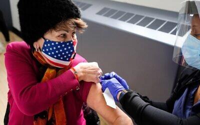 Zoya Goldovskaya received her first dose of the coronavirus vaccine at a pop-up site in Bensonhurst, Brooklyn for Holocaust survivors on Feb. 11, 2021.(Stephen Nessen/WNYC)