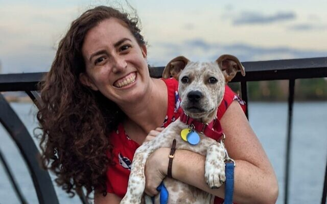 Sasha Kopp, who trains Jewish early childhood teachers, took up dog walking in Manhattan to fill time during the pandemic. Here she poses at Carl Schurz Park in New York City on July 16, 2020. (Carl Vitullo)