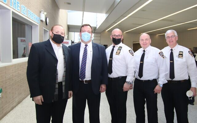 SAFETY FIRST: The Staten Island Council of Jewish Organization's Security Committee (COJO) coordinated its annual pre-Passover security and logistics meeting with the NYPD, FDNY and Sanitation Department, March 16, 2021. Left to right, Arie Weiss, chairman, COJO Security Committee; Mendy Mirocznik, president, COJO; Deputy Inspector Bruce Ceparano, Pct. 121; Captain Andrey Smirnov, commanding officer, Pct.123; and Inspector Robert Bower, Patrol Borough Staten Island. (COJO)