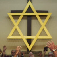 "A star of David hangs above the altar of a church in Middlesboro, Kentucky, featured in Maya Zinshtein's documentary about evangelical Christian support for Israel, ""'Til Kingdom Come.""(Abraham Troen/'Til Kingdom Come [2019] Film Ltd.)"