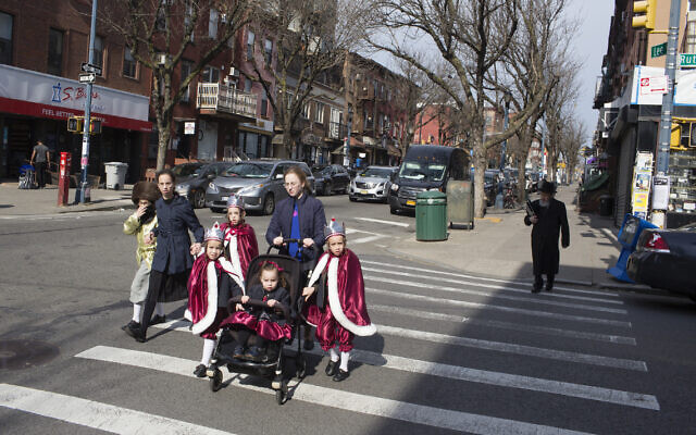 A family dressed up for Purim in the Williamsburg neighborhood of Brooklyn on March 10, 2020. (Andrew Lichtenstein/Corbis via Getty Images)