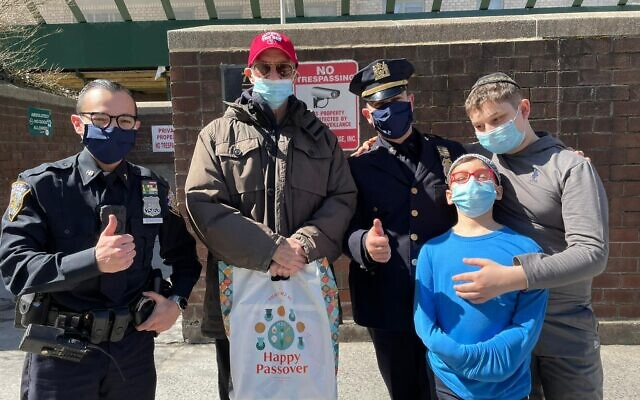 NEW YORK'S MOST GENEROUS: The NYPD Shomrim Society, the fraternal organization for Jewish law enforcement officers, held its Annual Passover Food Distribution, March 21, 2021. Dozens of members distributed food directly to residents in need across the city. (Courtesy)