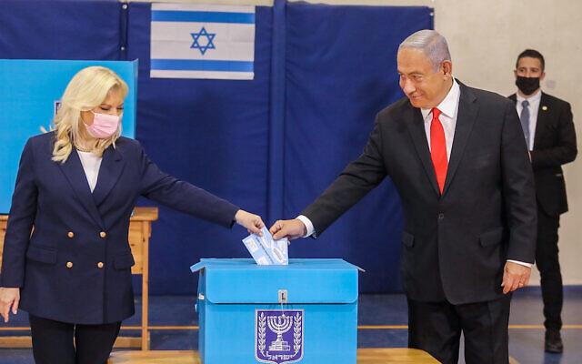 Israeli Prime Minister Benjamin Netanyahu and his wife, Sara, vote in Jerusalem on March 23, 2021. (Marc Israel Sellem/Flash90)