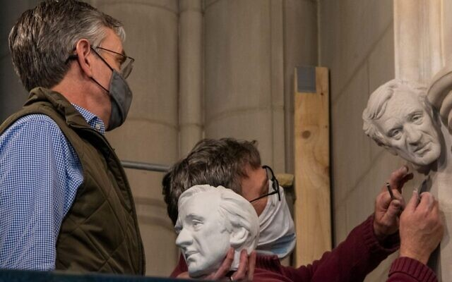 SET IN STONE: Washington's National Cathedral is honoring Elie Wiesel by installing a bust of the late Holocaust survivor and Nobel Peace Prize winner. In this undated photo, sculptor Chas Fagan, left, holds a clay model of the bust as stonemason Sean Callahan, right, carves the bust into the walls of the cathedral. (National Cathedral)