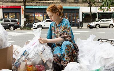 Anna Sacks rummages through New York City trash bags for usable, donatable goods. (Patricia Lopez Ramos)