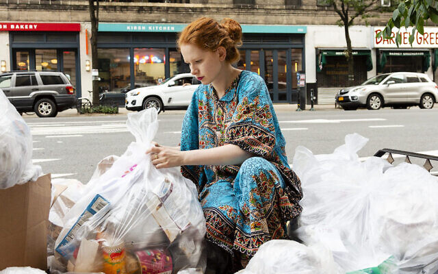 Anna Sacks rummages through New York City trash bags for usable, donatable goods. (Patricia Lopez Ramos)