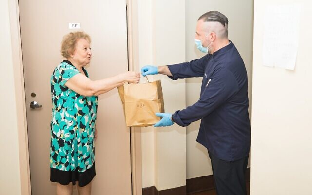 David Teyf delivers a Shabbat meal to a homebound Holocaust survivor in New York City, Aug. 21, 2020. (Benjamin Kanter)