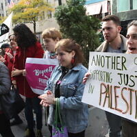 Demonstrators protest outside PUMA's flagship store in Manhattan over the company's sponsorship of the Israeli Football Association, which includes teams in illegal West Bank settlements, Aug. 26, 2019. (Joe Catron/Flickr Commons)