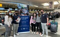AGAINST ALL ODDS: A few of the 241 teens enrolled in the Alexander Muss High School in Israel pose at JFK Airport before their April 6 flight to Israel on an El Al plane chartered by Jewish National Fund-USA, the program's sponsor. JNF-USA worked closely with Israeli government ministries, health authorities, El Al and Ben Gurion Airport to gain special permission for the students to enter the country. (JNF-USA)