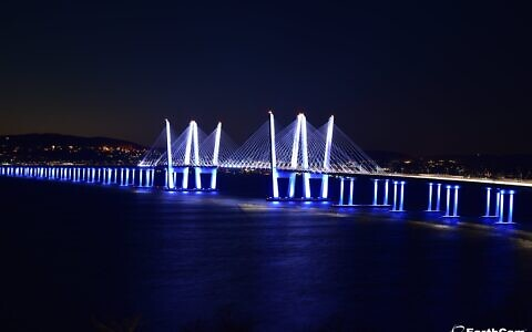 The Gov. Mario M. Cuomo Bridge over the Hudson was lit up in blue and white Tuesday evening in celebration of Israel's 73rd Independence Day. The initiative, which in the US was spearheaded by the Israeli-American Council, saw similar displays in cities across the globe. (Twitter)
