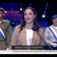 Gabriela Sztrigler Lew, a humanitarian worker from Mexico who volunteers with Shalom Cops, an organization established by the Ministry of Diaspora Affairs and the Jewish Agency, lights a torch at Israel's 73rd Independence Day Torch-Lighting Ceremony, April 14 2021. (Screen grab)