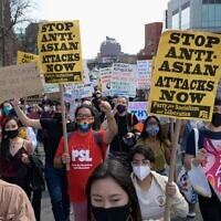 Members and supporters of the Asian-American community protest anti-Asian violence at a rally in Queens, March 27, 2021. (Angela Weiss/AFP via Getty Images)