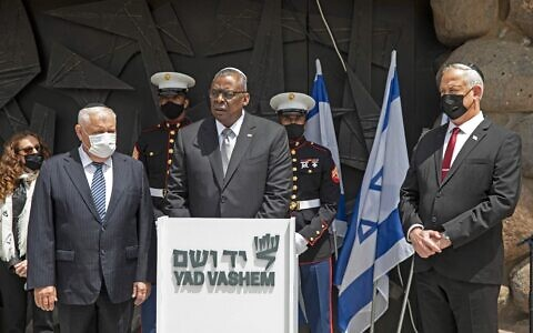 AUSTIN IN ISRAEL: US Secretary of Defense Lloyd Austin (c) is flanked by Israeli Defense Minister Benny Gantz (r) and acting chairman of Yad Vashem Holocaust Memorial Ronen Plot (l), at a ceremony in the Jerusalem memorial's Hall of Remembrance, April 12, 2021. Austin's arrival in Israel coincided with word of a sabotage attack on Iran's underground Natanz nuclear facility, for which Iran blames Israel. (Photo by Heidi Levine/AFP via Getty Images)