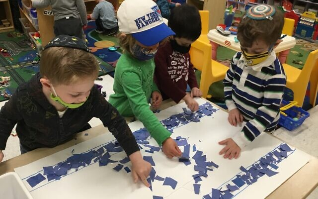 FLAG DAY: Children at HANC West Hempstead Early Childhood Center on Long Island celebrated Yom Ha'atzmaut, Israel's Independence Day, by creating Israeli flags and and birthday crowns. (Courtesy)