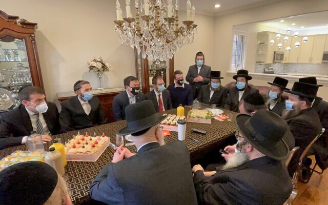 NYC mayoral candidate Andrew Yang, second from left, meets with haredi Orthodox Jewish leaders in Borough Park, in an undated photo supplied by his campaign. (Yang for New York)
