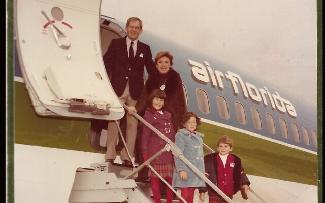 Eli Timoner stands with his family, including future rabbi Rachel Timoner, on a plane from the airline he founded. (Courtesy of Rachel Timoner)