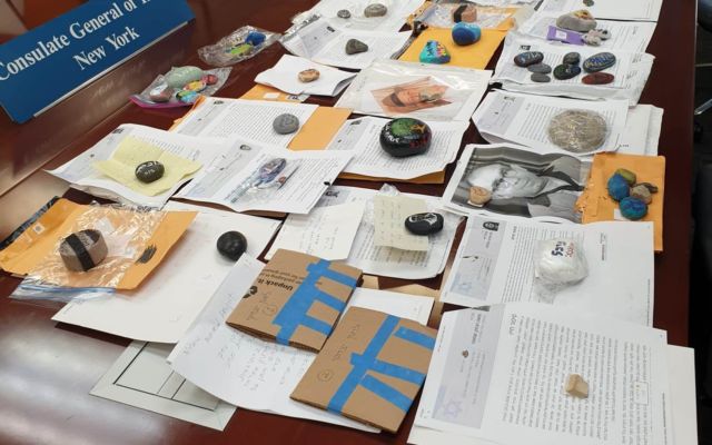 The Consulate General of Israel in New York has collected dozens of stones and commemorative letters from bereaved families in New York who are unable to travel to Israel to mourn loved ones on the country's Memorial Day, April 13. The mementos have been sent to Israel, where they will be placed on the graves of fallen soldiers by volunteers. (Consulate General of Israel)