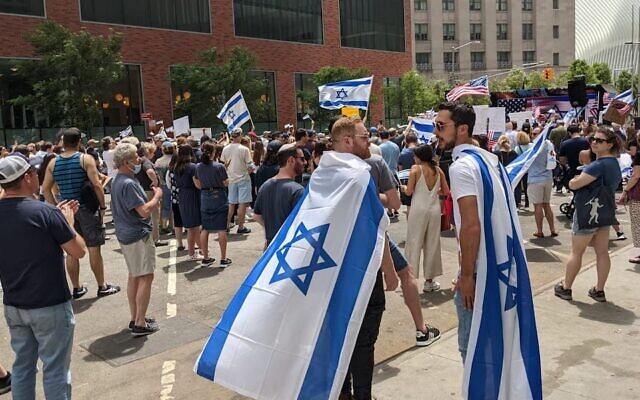 Two men wear Israeli flags at a pro-Israel rally in lower Manhattan on May 23, 2021. (Ben Sales)